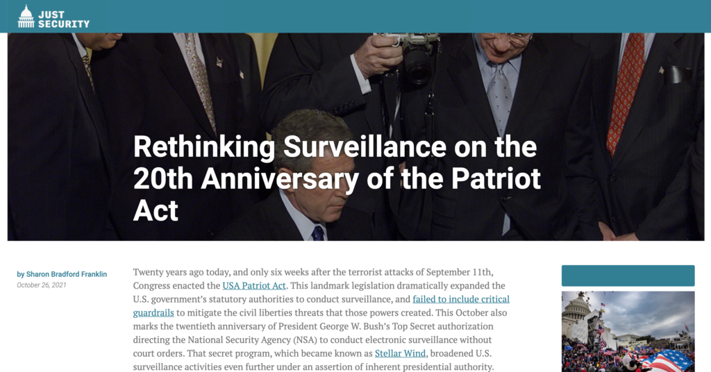 """CDT's Sharon Bradford Franklin penned a post about surveillance reform on the 20th anniversary of the passage of the Patriot Act. The post is on Just Security, entitled """"Rethinking Surveillance on the 20th Anniversary of the Patriot Act."""" White text on top of a photograph of the presidential signing of the Patriot Act."""